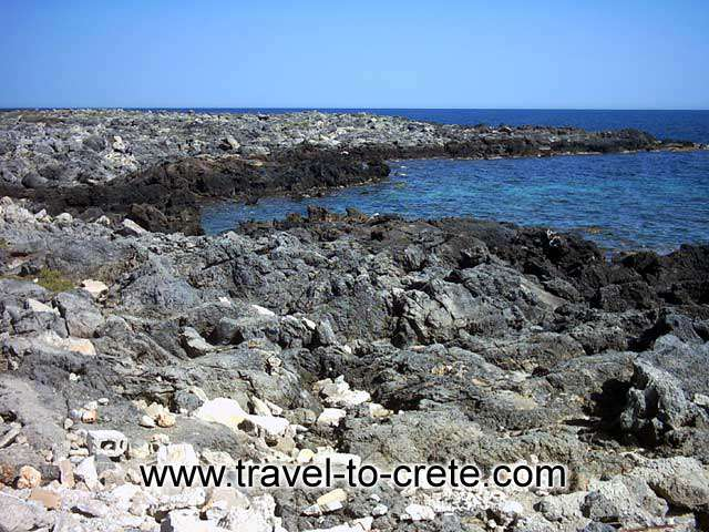 AKROTIRI STAVROS - The rocky left part of the bay