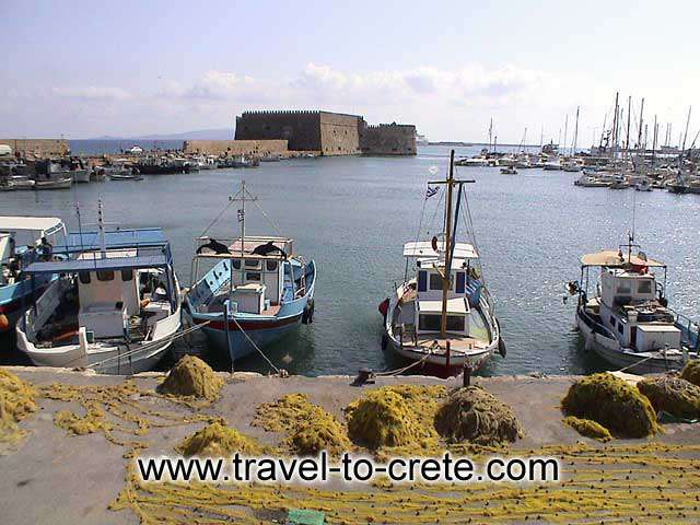 HERAKLION - Boats and fishing nets in Heraklion port