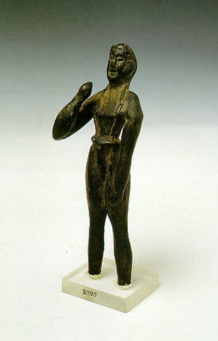 BRONZE FIGURINE - The large hall (84 x 38 m.) has an inclined floor and a small chamber opening to the left end; one of its niches is called the