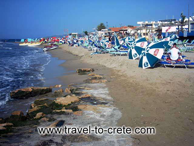 MALIA - A crowded part of the beach, where the water sports take place