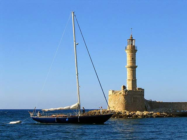 The old lighthouse at Chania's old port - The old lighthouse at Chania's old port is an all time classic shot. One from the many photos i took when i was there is this one. I liked a lot the view of the entrance of that boat in the port and the lighthouse.