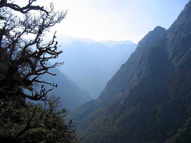 Samaria from above - On the first steps going down the Samaria Gorge (longest gorge in Europe) on the Greek island Crete i saw this view emerge out of the morning haze and it absolutely took my breath away (which I would become in dire need of later on the trip :-) by Karsten Palmvig