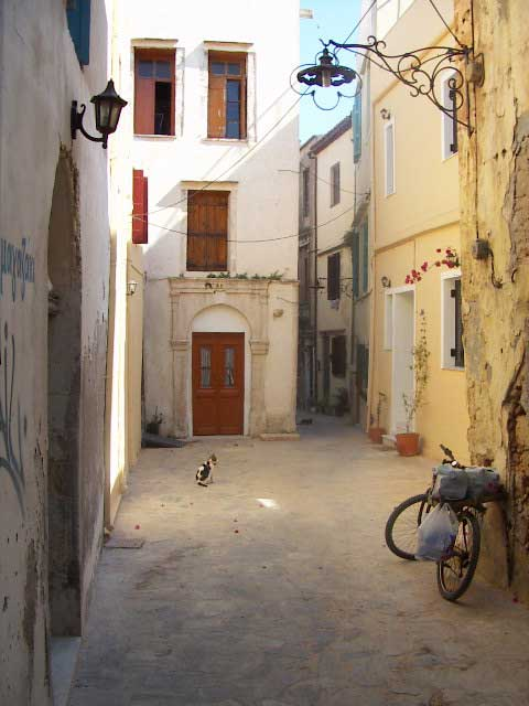 TRANQUILITY - An ordinary street in historic Chania. This city still has a lot of houses that date back to the time of the Venetian occupation. Take a step behind touristic lines and enter a world of small streets and porches where ordinary life continues in silence