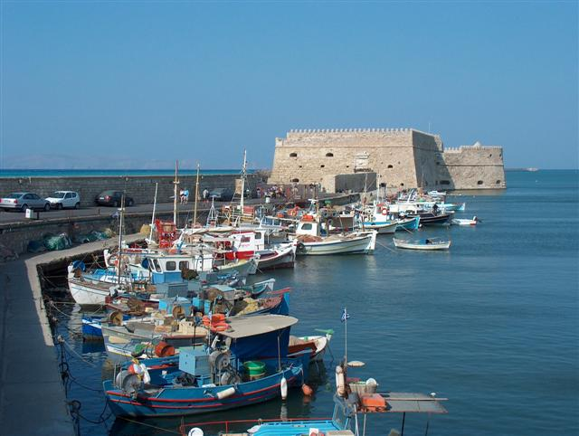 Koule fortress - Venetian fortress and the fishing port by Razvan Nedelcu