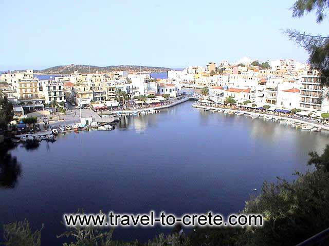 AGIOS NIKOLAOS - View from above. The town center of Agias Nikolaos is a deep lake (deep enough for the retreating Germans to dump all their tanks during WWII, and nobody has seen them since and actually is not a lake because it is connected to the sea.
