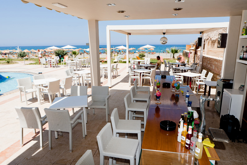The bar of Dimitrios Village is next to the sandy beach CLICK TO ENLARGE
