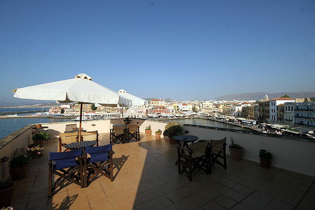 The veranda of Aphora Hotel next to the roof garden viewing to the old Venetian port of Hania CLICK TO ENLARGE